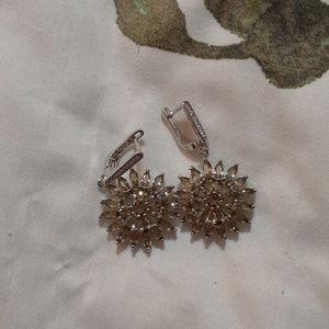 Silver flower shaped earrings